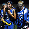 CARL RUSSO/Staff photo. Winnacunnet High School defeated Salem High School 2-0 in field hockey tournament action Thursday night. Salem's Alexandra Twomey (right) consoles her senior teammate Danielle Donovan as they walk off the field. 10/25/2012.