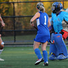 CARL RUSSO/Staff photo. Winnacunnet High School defeated Salem High School 2-0 in field hockey tournament action Thursday night. Salem's goalie, Brianna Rastello makes the save by kicking the ball out. 10/25/2012.