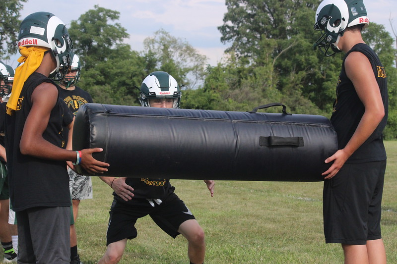 Flat Rock kicked off the 2017 season on Monday, which was the first official day for football practice in Michigan. The Rams are looking to build on last year's four-win season. (Photo Gallery by Ricky Lindsay)