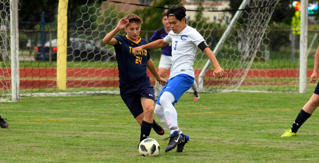 . Gibraltar Carlson\'s Christian Cuevas (3) battles Trenton\'s Luke VanAuken during Monday\'s boys\' soccer Downriver League opener. Guided by four goals from Cuevas, the visiting Marauders rolled to a 7-0 victory. Frank Wladyslawski - Digital First Media