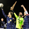 MARY SCHWALM/Staff photo. Windham players Alex Whitehead (10), Andrew Pesci (2) and Mike Sheahan acknowledge the fans after defeating Hollis Brookline in penalty kicks for the  NHIAA Division II State Championship soccer title in Exeter.   11/4/12