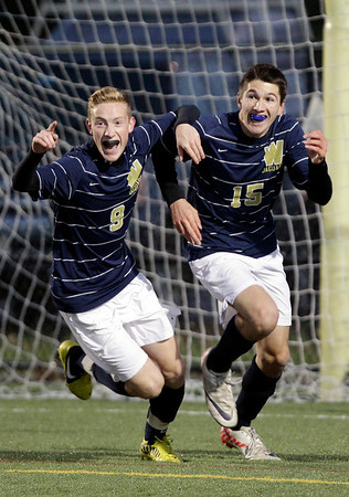 MARY SCHWALM/Staff photo. Windham players Casey Coupe (9) and David Carbonello (15) react after Carbonello scored a goal during the NHIAA Division II State Championship soccer game against Hollis-Brookline in Exeter.   11/4/12
