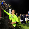 MARY SCHWALM/Staff photo. Windham goalie Andrew Pesci (2)is congratulated by the fans after defeating Hollis Brookline in penalty kicks for the  NHIAA Division II State Championship soccer title in Exeter.   11/4/12