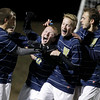 MARY SCHWALM/Staff photo. Windham players congratulate Joe Forti (20) after he scored a goal during the NHIAA Division II State Championship soccer game against Hollis-Brookline in Exeter.   11/4/12