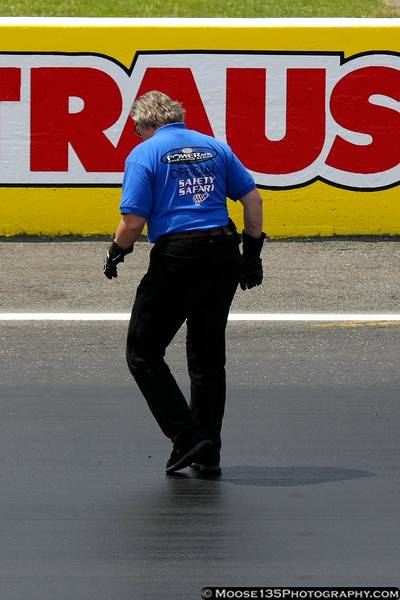 The NHRA Safety Safari inspects the track.
