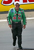 John Force inspects the track between qualifying rounds.