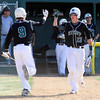 "Niwot High School's Tanner Morris (9) is greeted by Cameron Kopplinger after Morris scored in the 3rd inning during their game against Broomfield High School at Niwot High School on April 9, 2012.<br /> For more photos of the game go to  <a href=""http://www.bocopreps.com"">http://www.bocopreps.com</a><br /> Photo by Paul Aiken / The Camera"