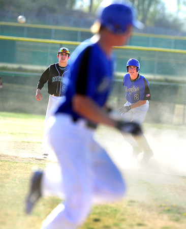 """Niwot High School's Tanner Morris (9) and Broomfield High School's Ryan McCulley (2) look to see if Gian Panicucci (6) beats out the throw during their game at Niwot High School on April 9, 2012.<br /> For more photos of the game go to  <a href=""""http://www.bocopreps.com"""">http://www.bocopreps.com</a><br /> Photo by Paul Aiken / The Camera"""