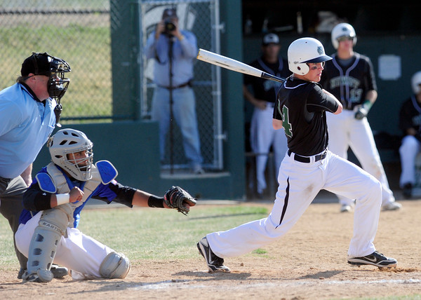"Niwot High School's Bryan Meek (26) hits an RBI single against Broomfield High School during their game at Niwot High School on April 9, 2012.<br /> For more photos of the game go to  <a href=""http://www.bocopreps.com"">http://www.bocopreps.com</a><br /> Photo by Paul Aiken / The Camera"