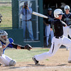 """Niwot High School's Bryan Meek (26) hits an RBI single against Broomfield High School during their game at Niwot High School on April 9, 2012.<br /> For more photos of the game go to  <a href=""""http://www.bocopreps.com"""">http://www.bocopreps.com</a><br /> Photo by Paul Aiken / The Camera"""