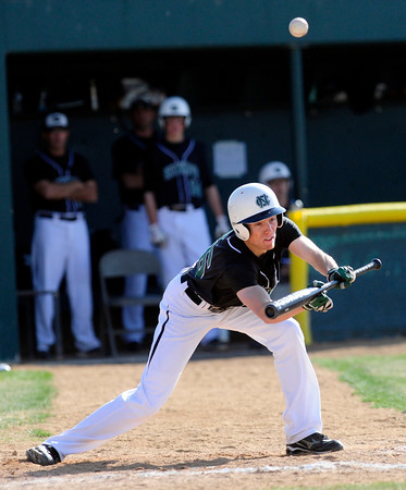 "\Niwot High School's Bryan Hawthorne tries to bunt a runner forward during their game against Broomfield High School at Niwot High School on April 9, 2012.<br /> For more photos of the game go to  <a href=""http://www.bocopreps.com"">http://www.bocopreps.com</a><br /> Photo by Paul Aiken / The Camera"
