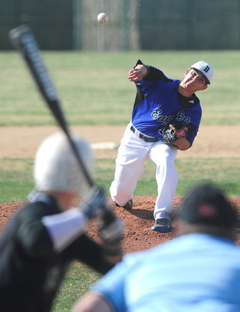 """Broomfield High School's Brandon Bailey (19) pitches against  Niwot High School during their game at Niwot High School on April 9, 2012.<br /> For more photos of the game go to  <a href=""""http://www.bocopreps.com"""">http://www.bocopreps.com</a><br /> Photo by Paul Aiken / The Camera"""