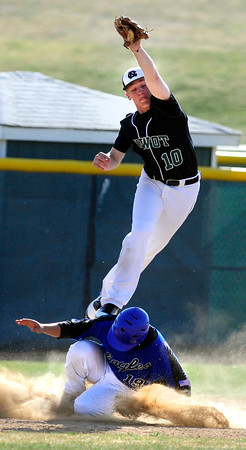 "Niwot High School's Pate Katechis (10) goes high over Broomfield High School's Brandon Bailey (19) after Bailey hit a triple during their game at Niwot High School on April 9, 2012.<br /> For more photos of the game go to  <a href=""http://www.bocopreps.com"">http://www.bocopreps.com</a><br /> Photo by Paul Aiken / The Camera"