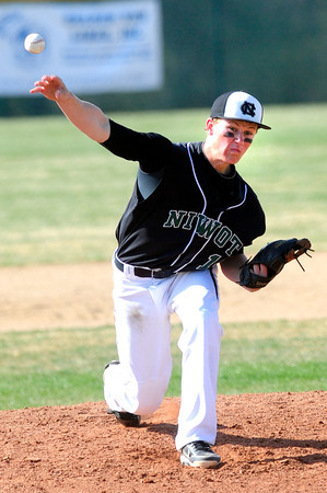 "Niwot High School's Bryan Meek (14) pitches against  Broomfield High School during their game at Niwot High School on April 9, 2012.<br /> For more photos of the game go to  <a href=""http://www.bocopreps.com"">http://www.bocopreps.com</a><br /> Photo by Paul Aiken / The Camera"