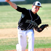 """Niwot High School's Bryan Meek (14) pitches against  Broomfield High School during their game at Niwot High School on April 9, 2012.<br /> For more photos of the game go to  <a href=""""http://www.bocopreps.com"""">http://www.bocopreps.com</a><br /> Photo by Paul Aiken / The Camera"""