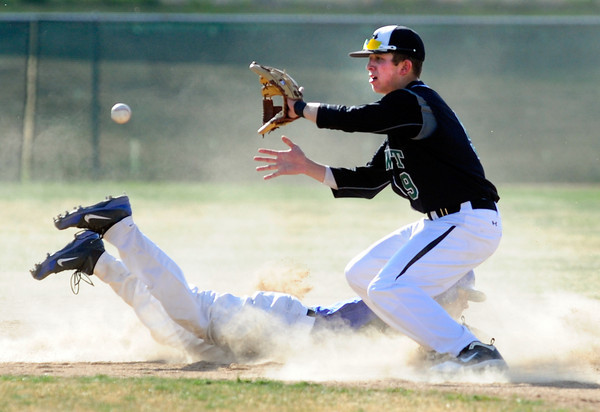 "Niwot High School's Tanner Morris waits for a pickoff throw as Broomfield High School's Todd Sena (8) slides back into second  during their game at Niwot High School on April 9, 2012.<br /> For more photos of the game go to  <a href=""http://www.bocopreps.com"">http://www.bocopreps.com</a><br /> Photo by Paul Aiken / The Camera"