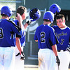 "Broomfield High School's Pat Lalancette (7) is greeted by teammates after hitting a 3 RBI home run again Niwot High School during their game at Niwot High School on April 9, 2012.<br /> For more photos of the game go to  <a href=""http://www.bocopreps.com"">http://www.bocopreps.com</a><br /> Photo by Paul Aiken / The Camera"