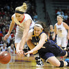NRHEG's Carlie Wagner, left, and Howard Lake-Waverly-Winsted's Makenzie Uter scramble for a loose ball during the first half of the Class AA semifinal game Thursday at Williams Arena. Pat Christman