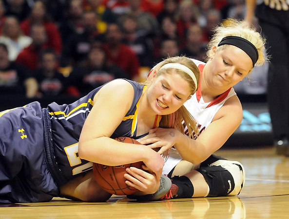 Howard Lake-Waverly-Winsted's Cozy Eastman and NRHEG's Jade Schultz battle for a loose ball during the first half of the Class AA semifinal game Thursday at Williams Arena. Pat Christman