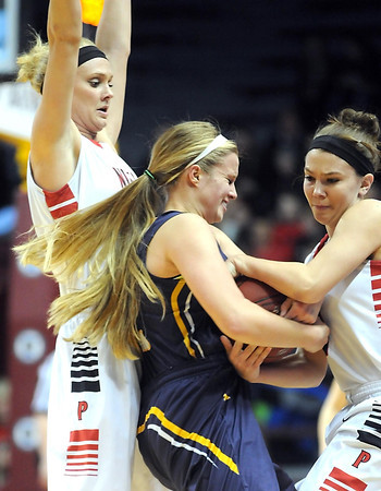 NRHEG's Carlie Wagner, left, and her sister Maddie pin Howard Lake-Waverly-Winsted's Gabby Gruenhagen during the first half of the Class AA semifinal game Thursday at Williams Arena. Pat Christman