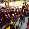 Young New Richland-Hartland-Ellendale-Geneva fans reach to get high fives from the girls basketball team as they take the court before the Class AA state tournament semifinal game against Howard Lake-Waverly-Winsted Thursday at Williams Arena. Pat Christman