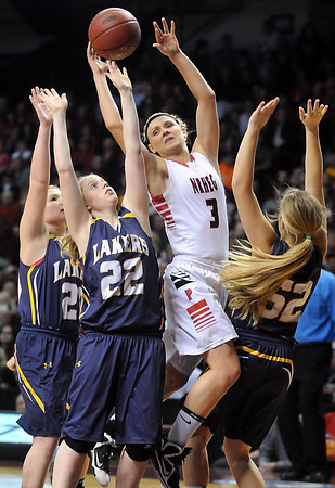 NRHEG's Carlie Wagner (3) passes out of a triple team of Howard Lake-Waverly-Winsted players during the second half of the Class AA semifinal game Thursday at Williams Arena. Pat Christman