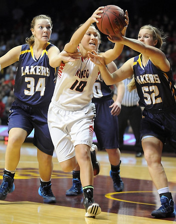 NRHEG's Paige Overgaard (10) beats Howard Lake-Waverly-Winsted's Marissa Reed (34) and Gabby Gruenhagen (52) to a rebound during the second half of the Class AA semifinal game Thursday at Williams Arena. Pat Christman