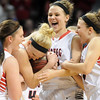NRHEG's Carlie Wagner is mobbed by her sisters Marnie, center, and Maddie, right, and teammate Kayley Camerer after setting the career state tournament scoring record formerly held by Janet Karvonen after the Panthers' Class AA semifinal win over Howard Lake-Waverly-Winsted Thursday at Williams Arena. Pat Christman