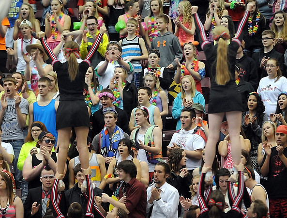 New Richland-Hartland-Ellendale-Geneva girls basketball fans are framed by cheerleaders as they cheer on the team during the Class AA quarterfinal game against Pequot Lakes Wednesday at Mariucci Arena. Pat Christman