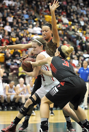 NRHEG's Paige Overgaard and Carlie Wagner defend Pequot Lakes' Kayla Miller during the first half of the Class AA quarterfinal game Wednesday at Mariucci Arena. Pat Christman