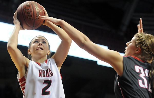 NRHEG's Marnie Wagner shoots around Kenyon-Wanamingo's Megan Quam during the second half of the Class AA state championship game Saturday at Williams Arena. Photo by Pat Christman