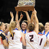 New Richland-Hartland-Ellendale-Geneva's Carlie Wagner, center, and the rest of the team hold up the Class AA state championship trophy after defeating Kenyon-Wanamingo 71-61 Saturday at Williams Arena. Photo by Pat Christman