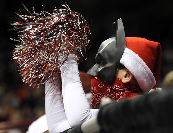 A NRHEG fan wears a Batman mask as he cheers during the second half of the Class AA state championship game Saturday at Williams Arena. Photo by Pat Christman