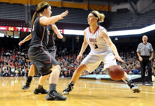NRHEG's Carlie Wagner faces a Kenyon-Wanamingo double team during the second half of the Class AA state championship game Saturday at Williams Arena. Photo by Pat Christman