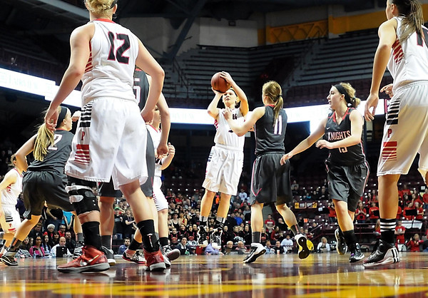 NRHEG's Carlie Wagner shoots during the second half of the Class AA state championship game Saturday at Williams Arena. Photo by Pat Christman