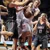 NREHG's Hannah Lundberg leaps for a rebound during the second half of the Class AA state championship game Saturday at Williams Arena. Photo by Pat Christman