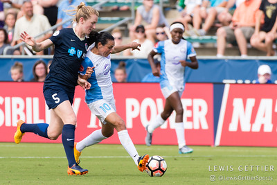 Marta (10) and Samantha Mewis (5) during a match between the NC Courage and the Orlando Pride in Cary, NC in Week 3 of the 2017 NWSL season. Photo by Lewis Gettier.