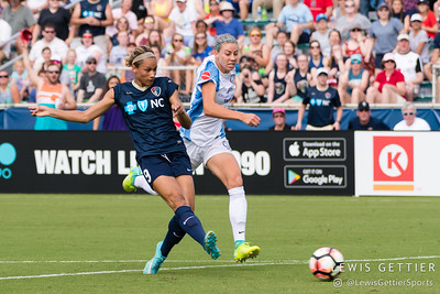 Lynn Williams (9) and Alanna Kennedy (14) during a match between the NC Courage and the Orlando Pride in Cary, NC in Week 3 of the 2017 NWSL season. Photo by Lewis Gettier.
