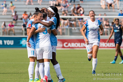 The Orlando Pride celebrate a goal by Camila Pereira (9) during a match between the NC Courage and the Orlando Pride in Cary, NC in Week 3 of the 2017 NWSL season. Photo by Lewis Gettier.