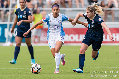 Kristen Edmonds (12) and McCall Zerboni (7) during a match between the NC Courage and the Orlando Pride in Cary, NC in Week 3 of the 2017 NWSL season. Photo by Lewis Gettier.
