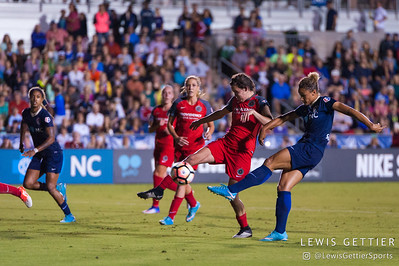 Lynn Williams (9) and Emily Menges (4) during a match between the NC Courage and the Portland Thorns in Cary, NC in Week 2 of the 2017 NWSL season. Photo by Lewis Gettier.