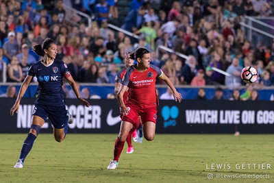 Abby Erceg (6) and Christine Sinclair (12) during a match between the NC Courage and the Portland Thorns in Cary, NC in Week 2 of the 2017 NWSL season. Photo by Lewis Gettier.