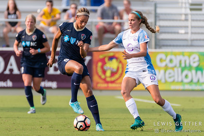 Lynn Williams (9) and Dani Weatherholt (17) during a match between the NC Courage and the Orlando Pride in Cary, NC in Week 3 of the 2017 NWSL season. Photo by Lewis Gettier.