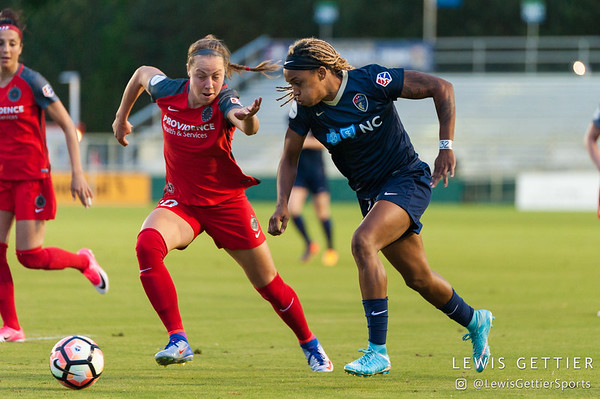 Celeste Boureille (30) and Jessica McDonald (14) during a match between the NC Courage and the Portland Thorns in Cary, NC in Week 2 of the 2017 NWSL season. Photo by Lewis Gettier.