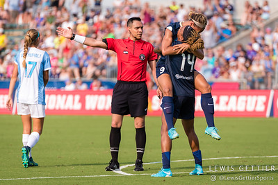Lynn Williams (9) celebrates her goal with Jessica McDonald (14) during a match between the NC Courage and the Orlando Pride in Cary, NC in Week 3 of the 2017 NWSL season. Photo by Lewis Gettier.