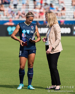 Amanda Duffy presents Lynn Williams (9) with her 2016 Golden Boot and MVP awards before a match between the NC Courage and the Orlando Pride in Cary, NC in Week 3 of the 2017 NWSL season. Photo by Lewis Gettier.