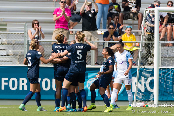 The NC Courage celebrate a goal by Jessica McDonald (14) during a match between the NC Courage and the Orlando Pride in Cary, NC in Week 3 of the 2017 NWSL season. Photo by Lewis Gettier.