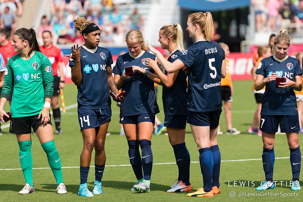 Players from the 2016 Western New York Flash receive their Championship rings before a match between the NC Courage and the Orlando Pride in Cary, NC in Week 3 of the 2017 NWSL season. Photo by Lewis Gettier.