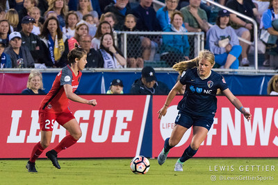 Meghan Klingenberg (25) and Makenzy Doniak (3) during a match between the NC Courage and the Portland Thorns in Cary, NC in Week 2 of the 2017 NWSL season. Photo by Lewis Gettier.