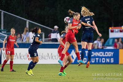 Samantha Mewis (5) and Allie Long (10) during a match between the NC Courage and the Portland Thorns in Cary, NC in Week 2 of the 2017 NWSL season. Photo by Lewis Gettier.